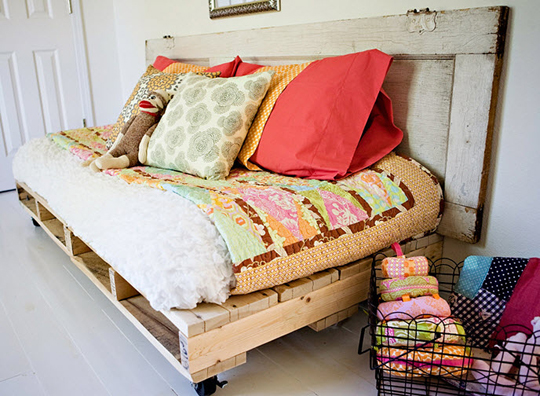 Daybed made from wooden pallets - found at apartmenttherapy.com